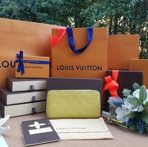 Louis Vuitton Zippy Empreinte wallet GENUINE